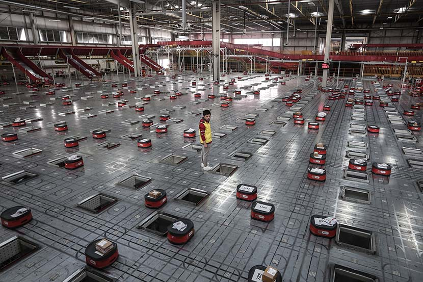 Robots sort packages at a warehouse owned by e-commerce firm JD.com in Wuhan, Hubei province, Nov. 5, 2019. VCG
