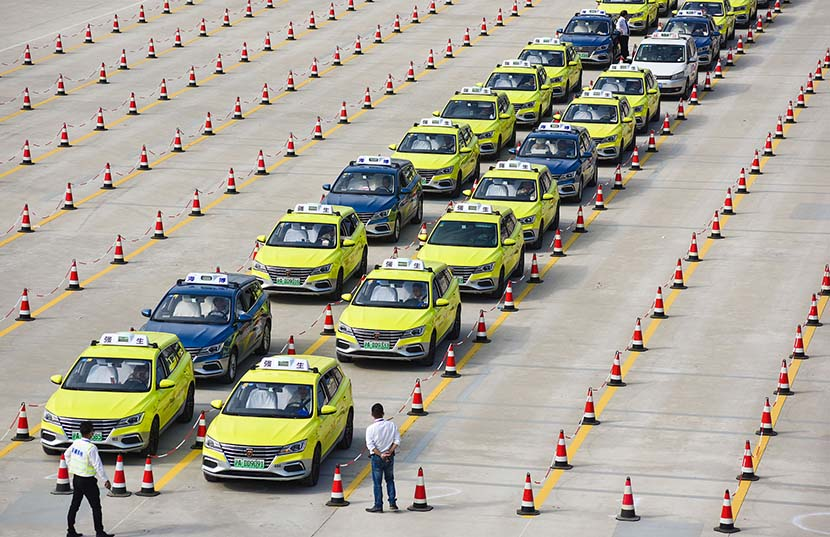 Taxis wait outside the National Exhibition and Convention Center during the 2nd China International Import Expo (CIIE), Shanghai, Nov. 6, 2019. Mai Tian/VCG
