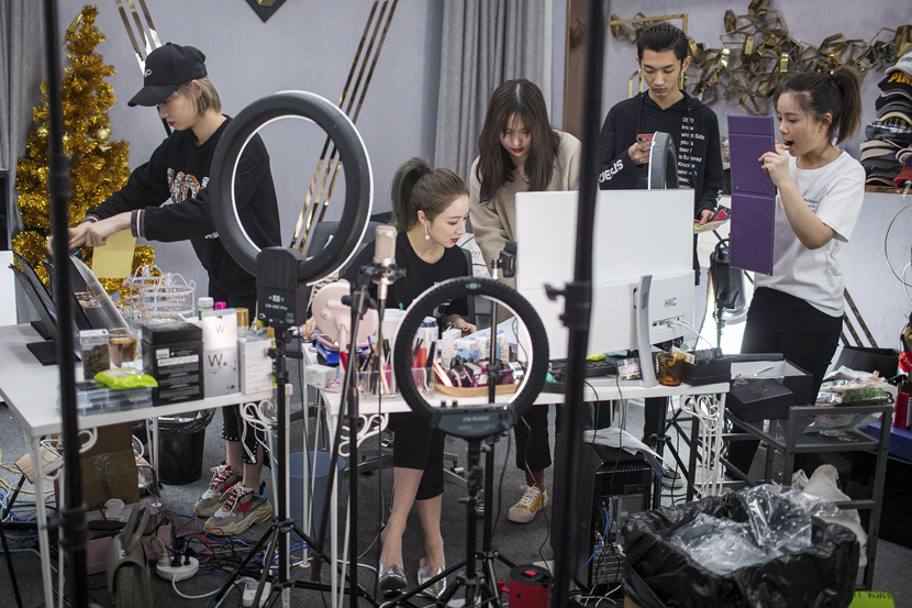 Viya (center), a top livestreamer on e-commerce site Taobao, prepares for a broadcast in Hangzhou, Zhejiang province, April 16, 2019. Chen Zhongqiu/VCG