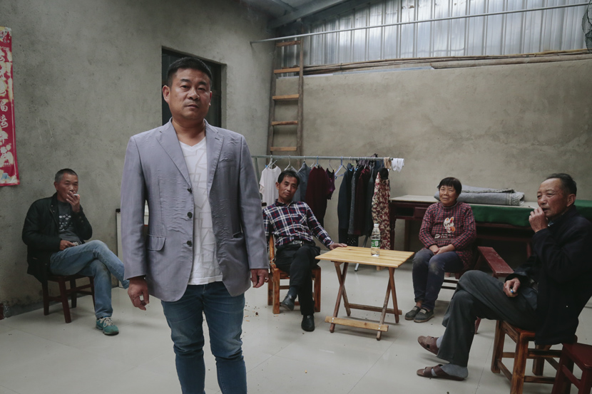 Li Yusong (in the gray suit) poses for a photo with others in a fishing village in Honghu, Hubei province, Oct. 22, 2019. Li You/Sixth Tone