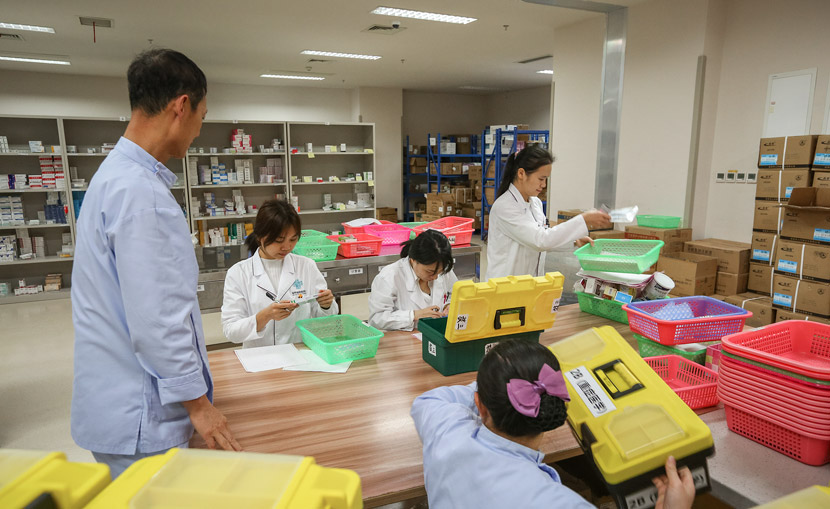 Pharmacists dispense medication at a hospital in Haikou, Hainan province, Jan. 24, 2019. Yuan Chen/VCG