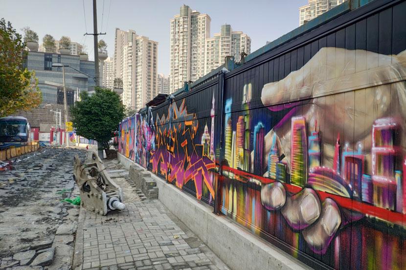 The graffiti wall on Moganshan Road in Shanghai, Dec. 3, 2019. Kenrick Davis/Sixth Tone