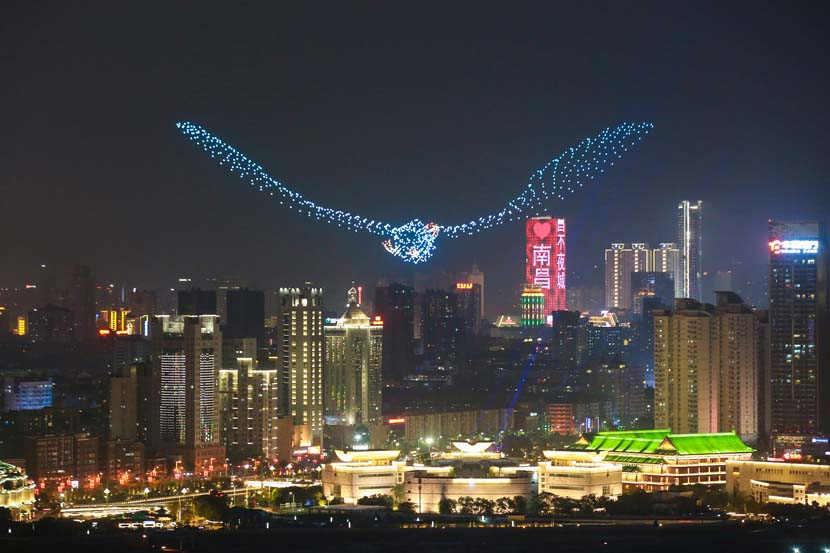 A fleet of 1,100 unmanned aerial vehicles flies in the formation of a bird above the Pavilion of Prince Teng to celebrate the launch of this year's Poyang Lake International Bird Watching Week in Nanchang, Jiangxi province, Dec. 5, 2019. Ma Yue/VCG