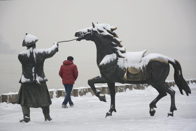 A man walks through the snow in Jilin, Jilin province, Dec. 11, 2019.