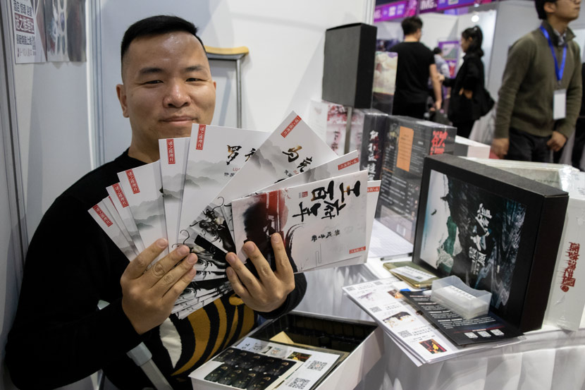 Wang Zhe shows his box set games at the International Mystery Game Expo in Shanghai, Nov. 14, 2019. Kenrick Davis/Sixth Tone
