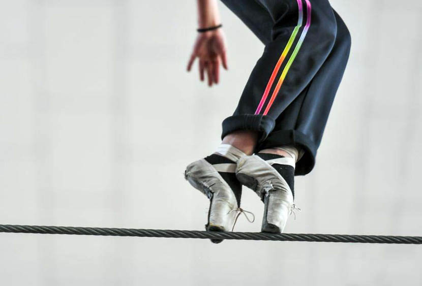 A girl practices walking along a tightrope at a traditional arts school in Yengisar County, Xinjiang Uyghur Autonomous Region, Dec. 17, 2019. Liu Xin/CNS
