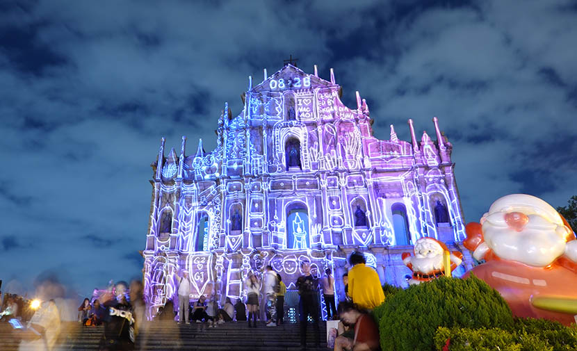 A light show at the Ruins of St. Paul's is held to celebrate the 20th anniversary of Macao's handover to China, Dec. 16, 2019. Xinhua
