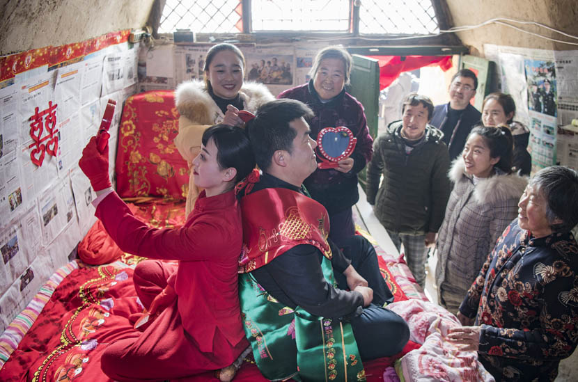A traditional wedding ceremony is held in Zhidan County, Shaanxi province, Dec. 18, 2019. Tao Ming/Xinhua