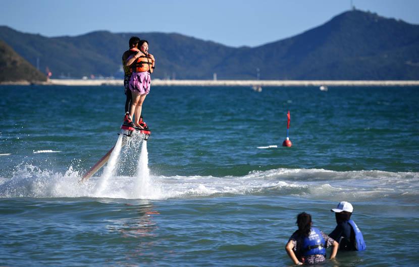 Tourists enjoy aquatic activities in Sanya, Hainan province, Dec. 21, 2019. Guo Cheng/Xinhua