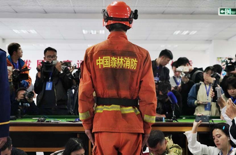 A surviving firefighter attends a press conference after a deadly forest fire killed 27 firefighters and three people from the local fire department in Muli County, Liangshan Yi Autonomous Prefecture, Sichuan province, April 3, 2019. IC