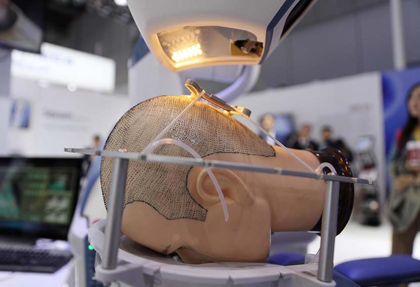 A robotic hair transplant machine is seen on day two of the 2nd China International Import Expo (CIIE) at the National Exhibition and Convention Center in Shanghai, Nov. 6, 2019. Zhang Hengwei/CNS/VCG