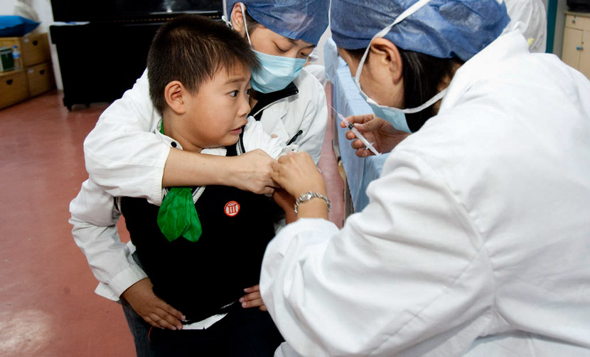 A boy receives an injection in Shanghai, 2009. Zhang Dong for Sixth Tone