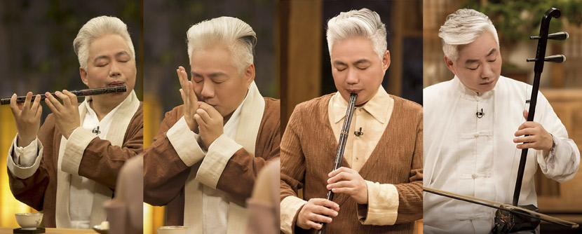 Fang Jinlong plays different instruments during a TV show. From @邻家诗话 on Weibo