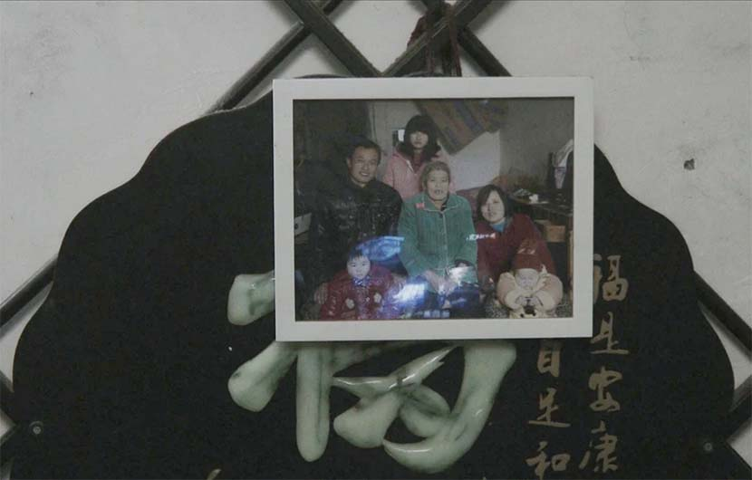 A framed photo from a family dinner in April. Courtesy of Zhu Shengze
