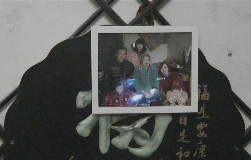 A framed photo from a family dinner in April. Courtesy of Zhu Shengze