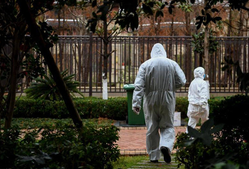 Medical workers inspect a residential community where suspected coronavirus infections have been found, Kunming, Yunnan province, Jan. 29, 2020. Kang Ping/CNS