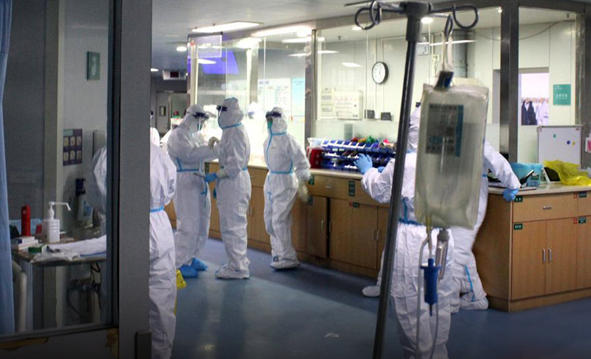 Doctors and nurses in a full protective suit at Zhongnan Hospital in Wuhan, Hubei province, Jan. 25, 2020. Zhou Qunfeng/CNS