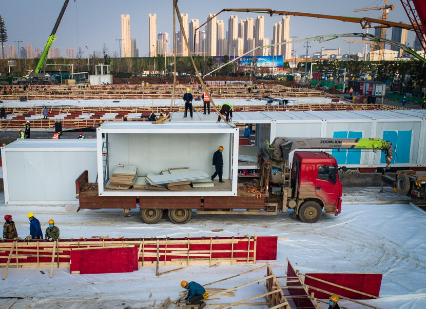 Workers continue the construction of another special new facility, named Leishenshan Hospital, in Wuhan, Hubei province, Jan. 30, 2020. Xiao Yijiu/Xinhua