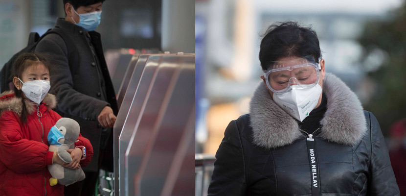 Passengers wearing face masks enter Shanghai Railway Station in Shanghai, Jan. 31, 2020. Yi Chuan for Sixth Tone