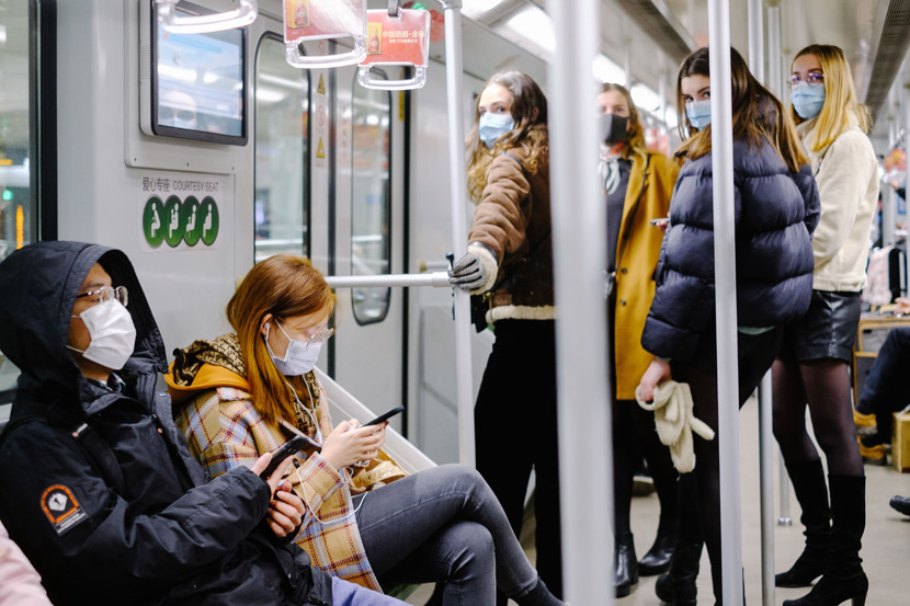 Passengers wear face masks on the subway in Shanghai, Feb. 10, 2020. People have had to wear masks when entering subway stations since Feb. 5, according to the Shanghai Metro. Wu Huiyuan/Sixth Tone