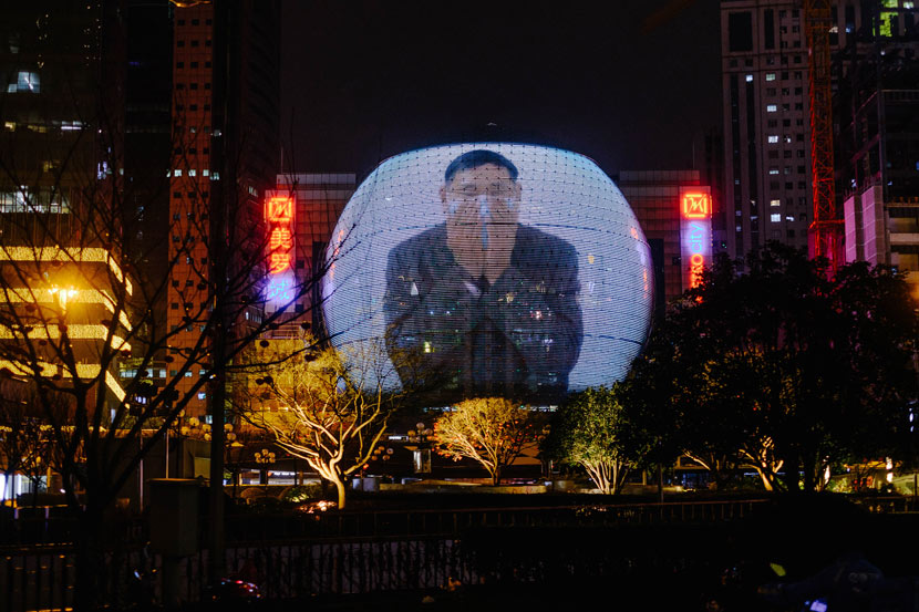 A spherical display shows a video encouraging people to properly wear face masks in Shanghai, Feb. 10, 2020. Wu Huiyuan/Sixth Tone