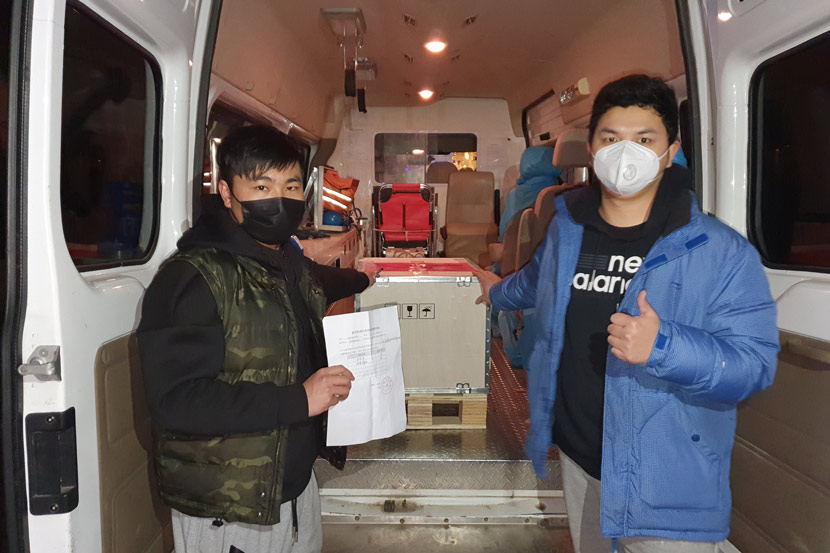 Volunteers pose for a photo while transporting medical supplies in Xiaogan, Hubei province, 2020. Courtesy of Guo Fei's volunteer group
