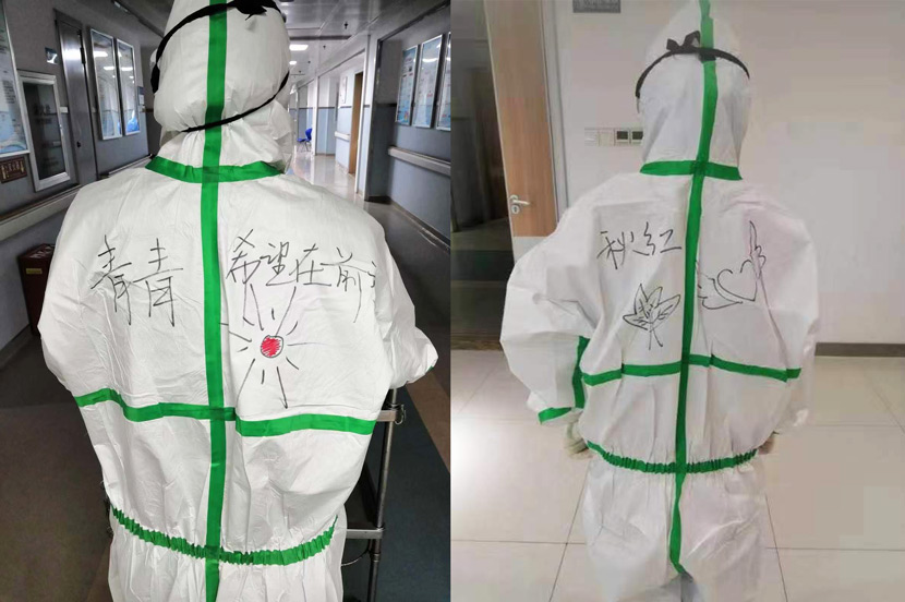 Medical workers show off the encouraging words written on the protective suits supplied with the help of Guo's team in Xiaogan, Hubei province, 2020. Courtesy of Guo Fei's volunteer group