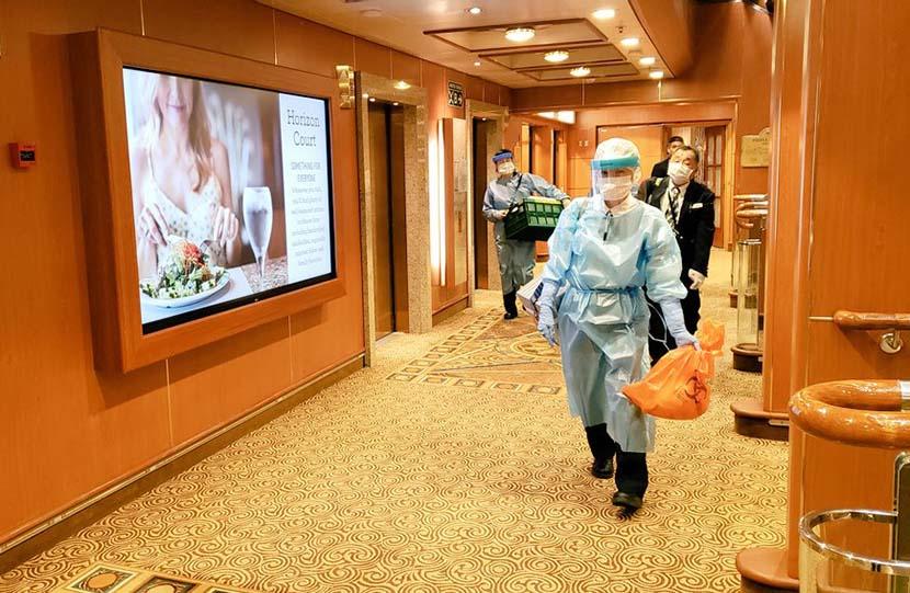 Medical workers walk down a hallway on the Diamond Princess cruise ship, currently under quarantine in Yokohama, Japan, Feb. 6, 2020. Xinhua
