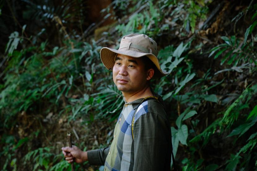 Zuo Changsheng, deputy director of Tongbiguan Nature Reserve in Yingjiang, poses for a photo in the reserve, Yingjiang County, Dehong autonomous prefecture, Yunnan province, Jan. 16, 2020. Li You/Sixth Tone