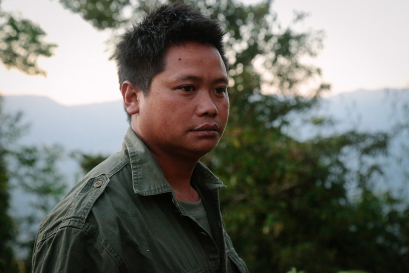 Mi Magan poses for a photo in Shiti Village, Yingjiang County, Yunnan province, Jan. 15, 2020. Li You/Sixth Tone