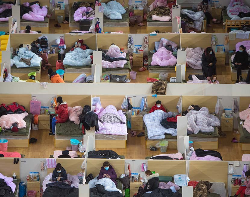 "Patients at a ""shelter hospital"" in Wuhan, Hubei province, Feb. 17, 2020. Xinhua"