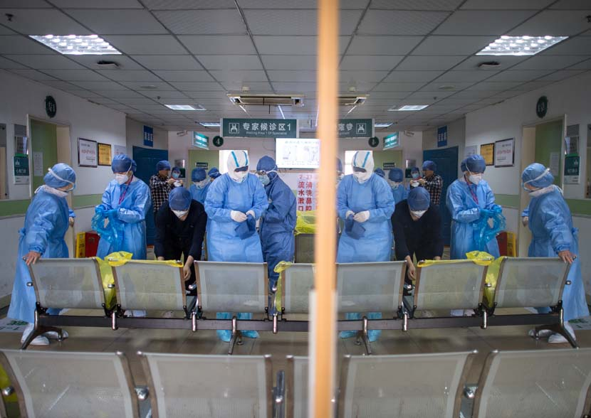Medical workers put on protective equipment at Wuhan No. 1 Hospital, Hubei province, Feb. 22, 2020. Xinhua