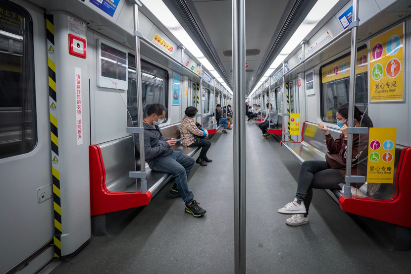 People take the subway in Guangzhou, Guangdong province, Feb. 23, 2020. Li Zhihao/IC