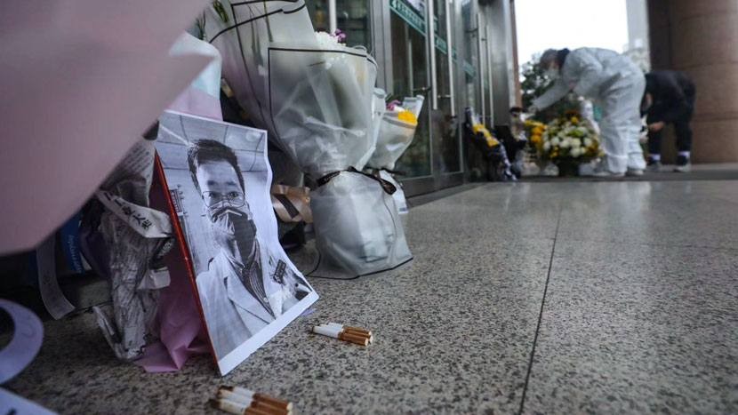 A mourner has left a tribute for Dr. Li Wenliang, the whistleblower who died after becoming infected with the novel coronavirus, Wuhan, Hubei province, Feb. 7, 2020. Yuan Zheng for Sixth Tone