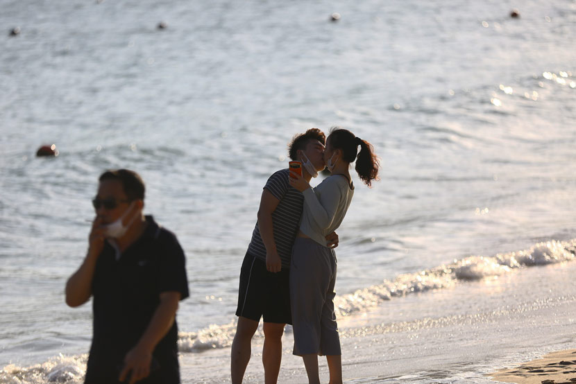 A couple takes a selfie on the beach in Sanya, Hainan province, Feb. 23, 2020. IC
