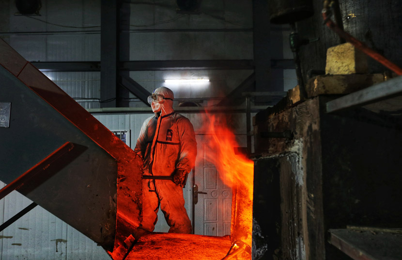 A worker stands near an incinerator at a medical waste processing site for Leishenshan Hospital in Wuhan, Hubei province, Feb. 23, 2020. Cui Meng/Global Times