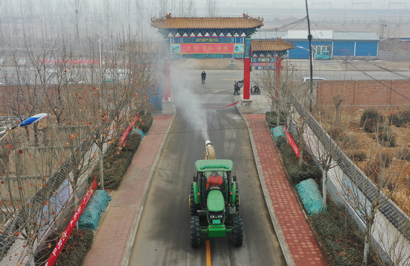 Disinfectant is sprayed from a tractor in a neighborhood of Luanzhou, Hebei province, Feb. 14, 2020. Yu Aishuang via Xinhua