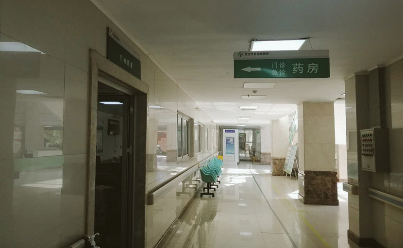 A view of a corridor near the pharmacy where volunteers collect anti-HIV medicine at Jinyintan Hospital in Wuhan, Hubei province, Feb. 20, 2020. Courtesy of MJ