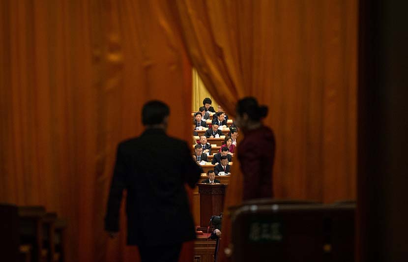 "A delegate enters the Great Hall of the People in Beijing to attend a meeting during the ""two sessions,"" March 8, 2018. EPA/Roman Pilipey/IC"