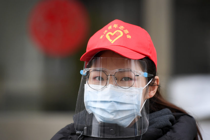 A young volunteer working at a residential community in Wuhan, Hubei province, March 7, 2020. Chen Yehua/Xinhua