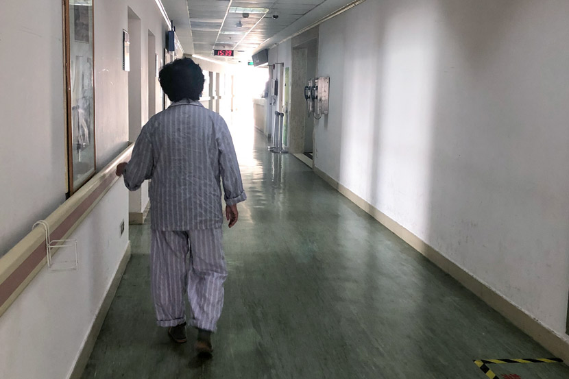 Bao Wei's mother, after undergoing surgery Thursday, has started walking along the hospital's corridor for exercise, in Shanghai, March 2020. Courtesy of Bao Wei