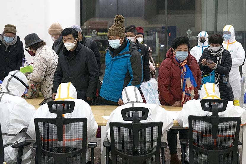 Medical workers register incoming patients at a temporary hospital in Wuhan, Hubei province, Feb. 5, 2020. Xinhua