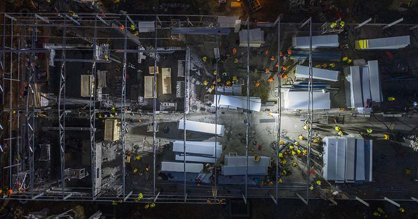 Laborers work overnight to build the Huoshenshan quarantine hospital in Wuhan, Hubei province, Jan. 30, 2020. Xinhua
