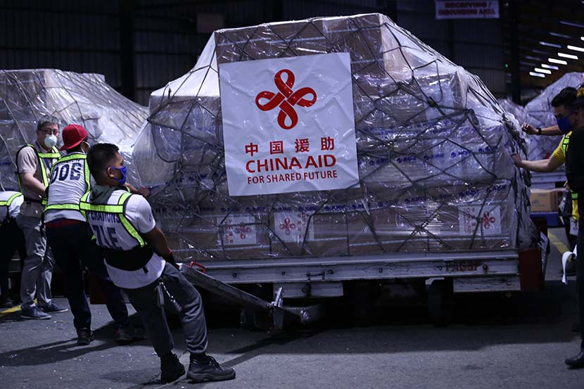 Workers transport medical supplies donated from China at an airport in Manila, Philippines, March 21, 2020. Yang Ke/Xinhua