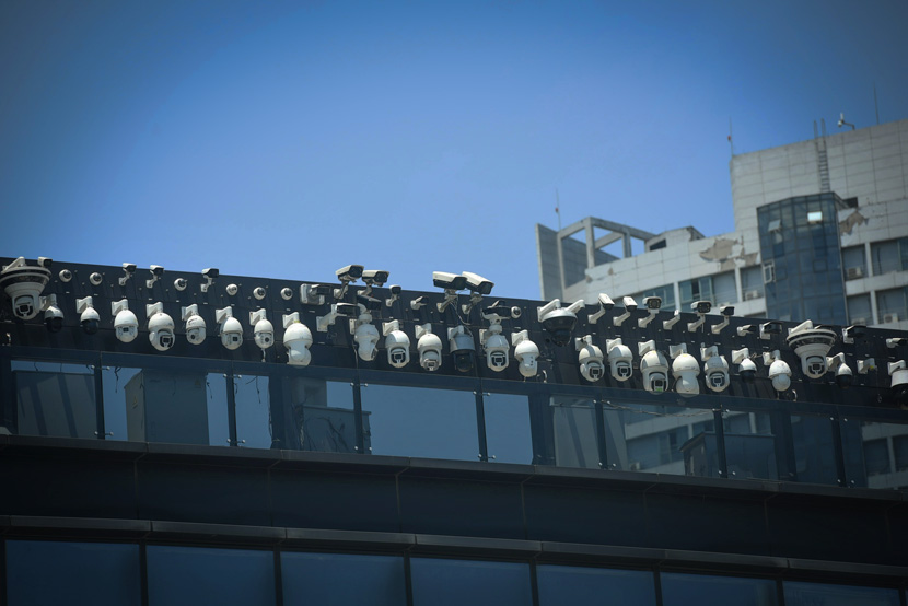 Lines of surveillance cameras can be seen on a building in Hangzhou, Zhejiang province, May 29, 2019. Long Wei/IC