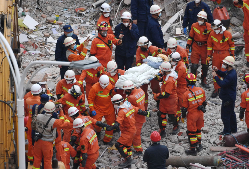 A man who was trapped for 69 hours in the rubble of a collapsed quarantine hotel is rescued in Quanzhou, Fujian province, March 10, 2020. Lin Shanchuan/Xinhua
