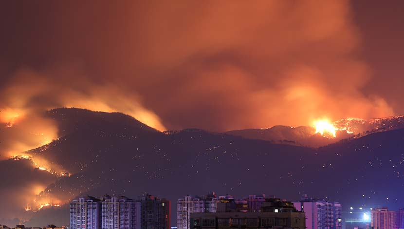 A forest fire rages near Xichang, Sichuan province, March 31, 2020. Eighteen firefighters and one guide were killed battling the blaze. Xinhua
