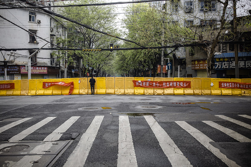A man looks over a barrier in Wuhan, Hubei province, March 22, 2020. Gerry Yin/Wild Photos
