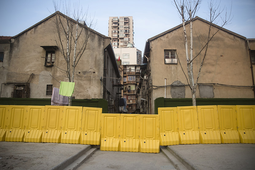 Barriers close off a residential community in Wuhan, Hubei province, Feb. 23, 2020. After the yellow walls were erected in mid-February, residents, still preoccupied with the outbreak, largely left them alone. Gerry Yin/Wild Photos