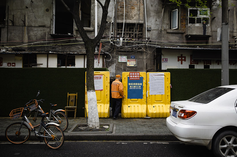 A sanitation worker enters a residential community in Wuhan, Hubei province, March 22, 2020. Gerry Yin/Wild Photos
